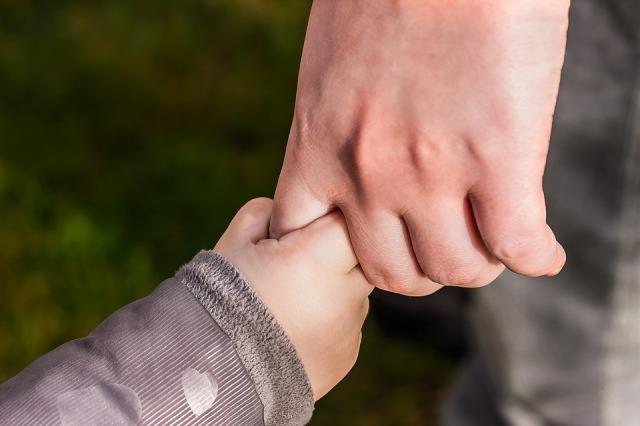 holding-child's-hand